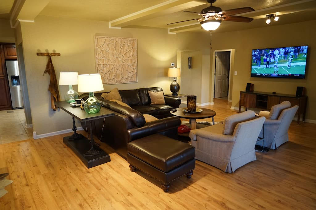"""Cozy living room with 65"""" TV, cable, and Netflix. Couch could sleep two."""
