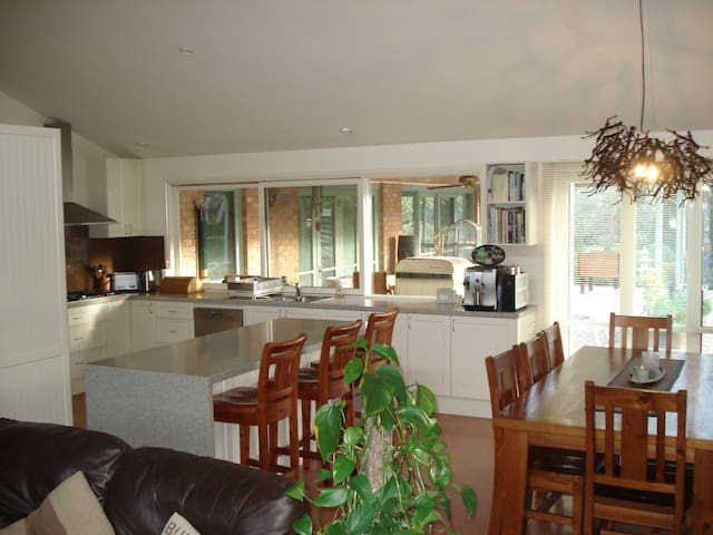 Living area, with large kitchen, easy to use coffee machine and breakfast bar