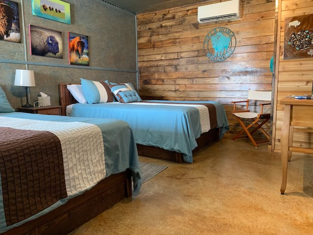 two queen beds in the Rojo Buffalo Cabin at The Lazy Buffalo