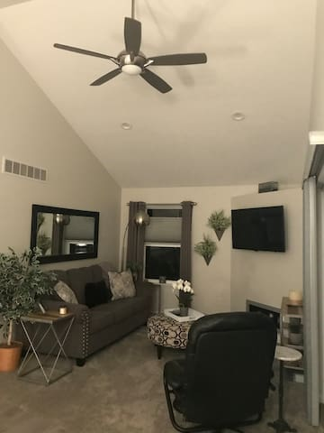 """Living room with 47"""" flat screen tv. Couch and reclining chair."""