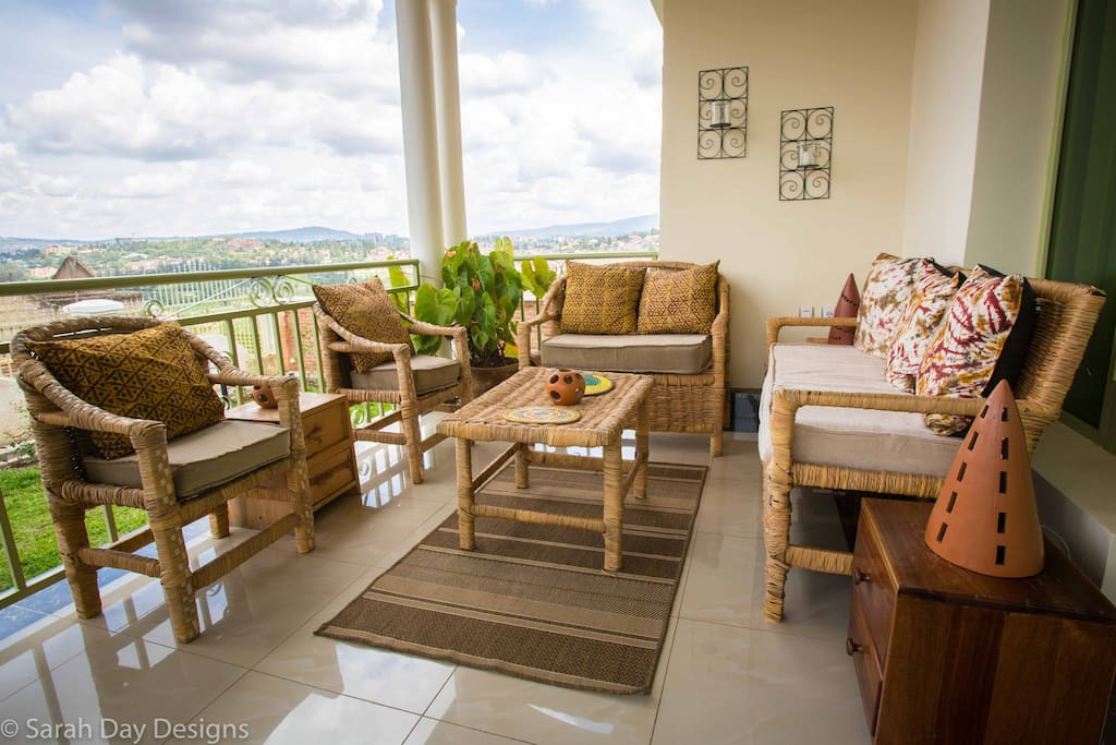 Front porch has a cozy sitting space and a breakfast table!