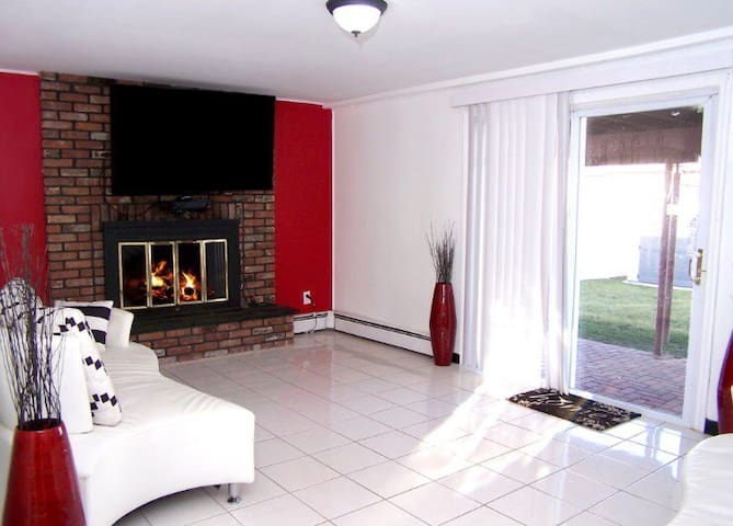 """Guest private living room with 65"""" inch flat tv with cable and fireplace"""