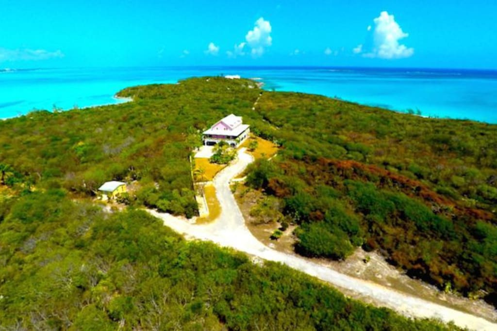 Aerial view. I built this home to celebrate the beautiful ocean and sunsets of Exuma. I am a native Exumian and consider this my oasis.  The house leads directly to a private white sand beach 5 minutes walking distance!