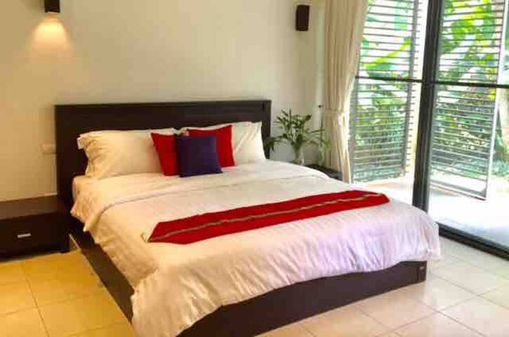 The Main bedroom, where you can directly walk 20 steps to the main swimming pool
