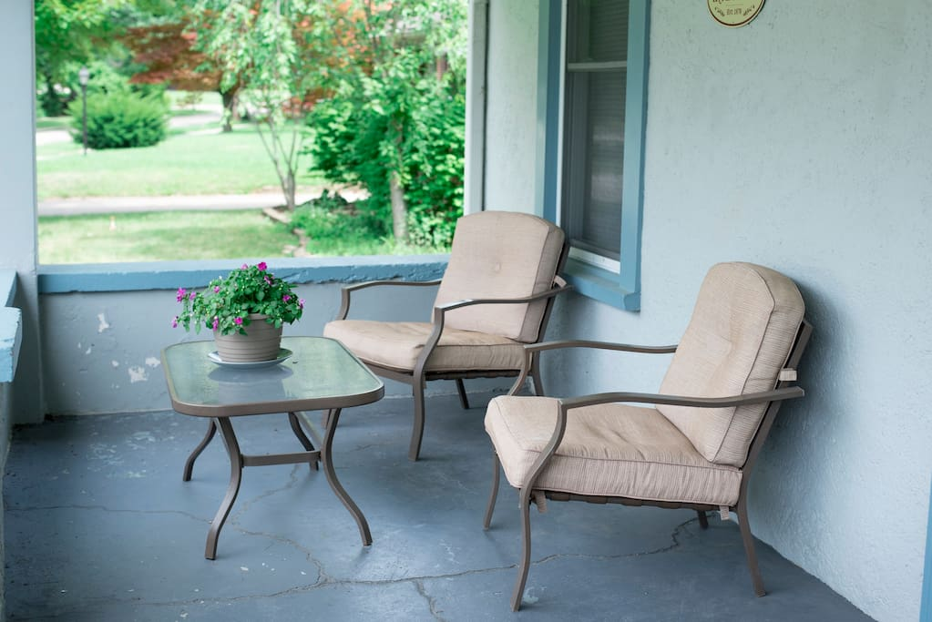 Large front porch chairs offer a great place for you to enjoy the quiet neighborhood