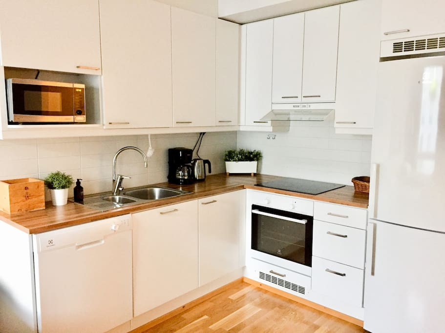 Well equipped kitchen with modern appliances.