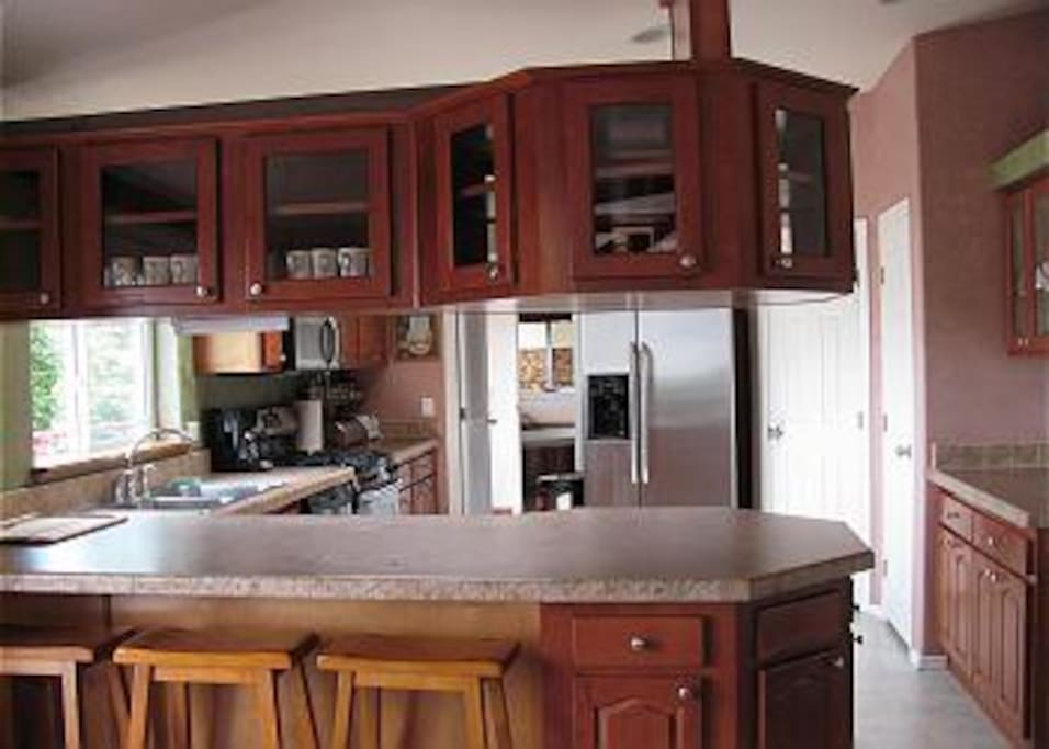 The kitchen is great place to gather and cook with seating for 3 at the breakfast bar.