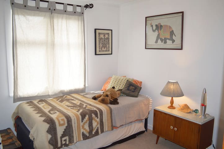 Bedroom 3....king single with a single underneath that makes a big king as well as can be used separately. This room has art from our travels to Africa, India, Bali, Tonga and Mexico.