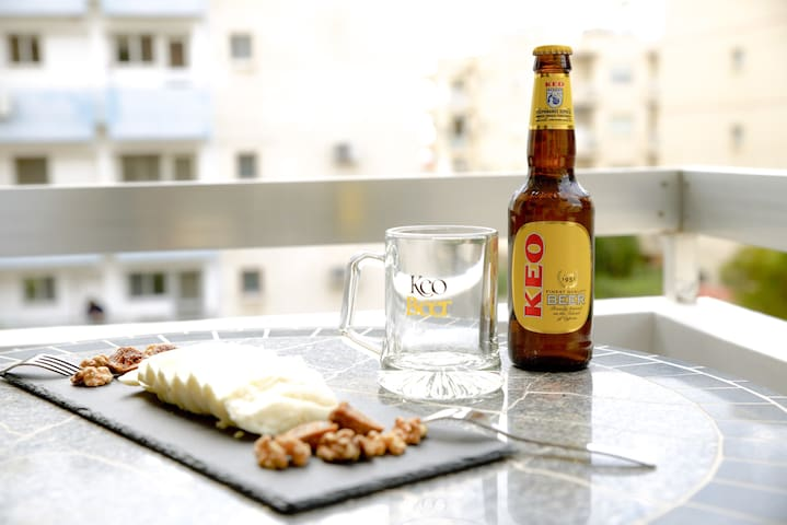 Try some local beer, KEO and halloumi.