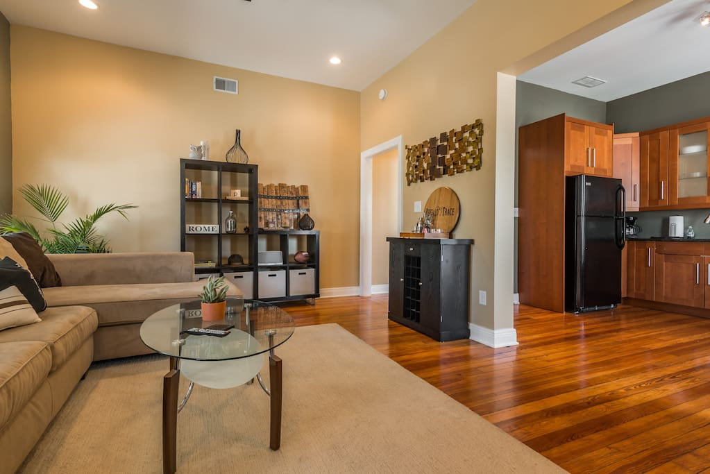 Spacious living area with room for parties of all sizes.  Surrounded by gorgeous restored 100 year old floors.