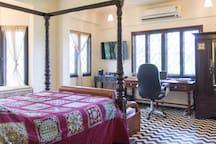 Master bedroom with en suite bathroom and desk area.