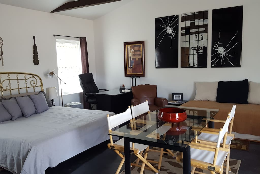 Studio includes one king bed, 2 single beds, a dining room table, desk, workspace, and bathroom