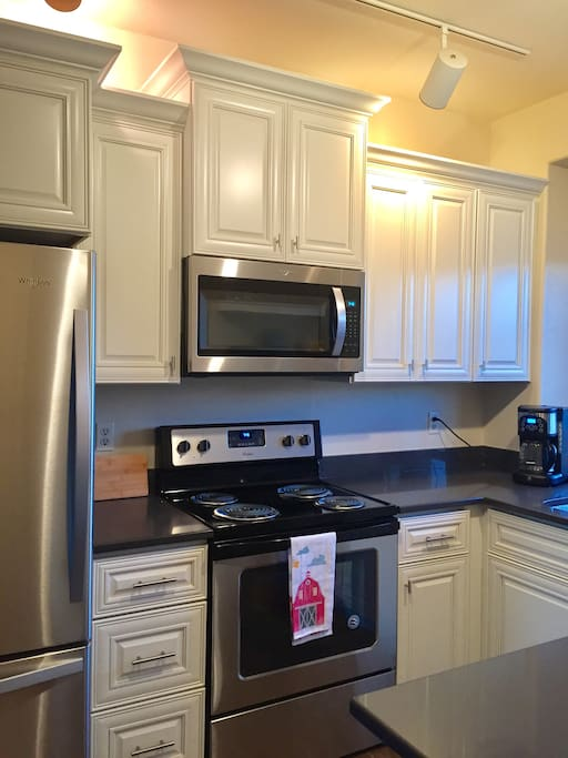 Completely new custom kitchen with quartz countertops and all new Whirlpool appliances.