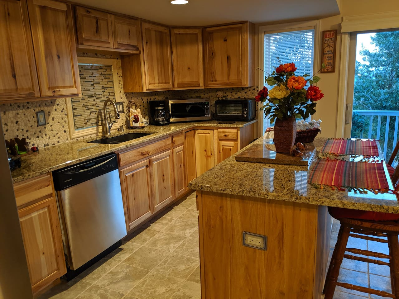 Newly remodeled kitchen with lots of supplies for cooking.