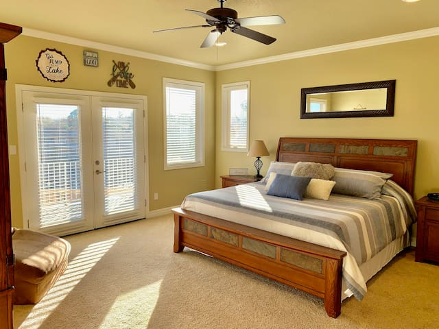 Master suite w/French doors to balcony and ensuite bathroom