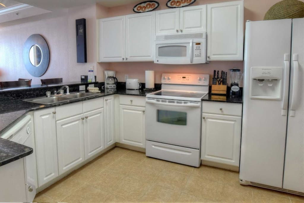 Spacious Kitchen with coffee maker, blender, toaster etc