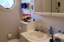 Bathroom, right across the hallway from the bedroom. Please note to wash dishes in kitchen sink, not in the bathroom.