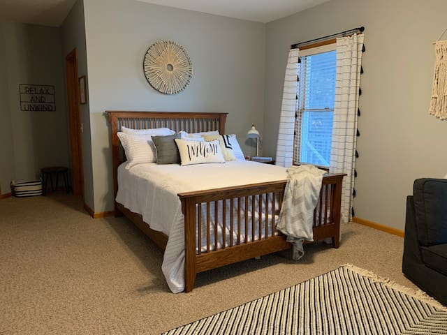 """The best bedroom in the whole house with its large windows and amazing lake views.  This bedroom features a queen size bed.  Extra bedding and blankets can be found in the drawers.  We call this the """"Boho"""" room and it's Brady's favorite."""