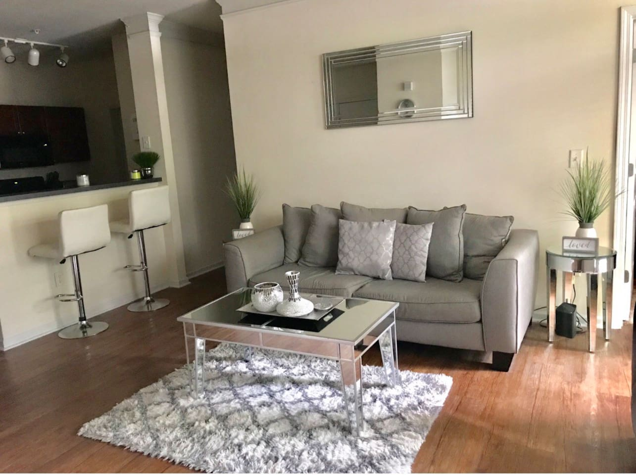 This is the very spacious and clean living room you will see upon entering.