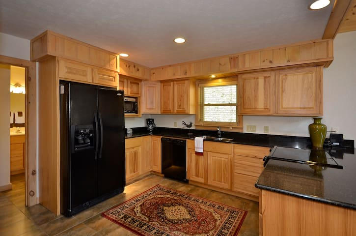 Well appointed kitchen with granite counter tops