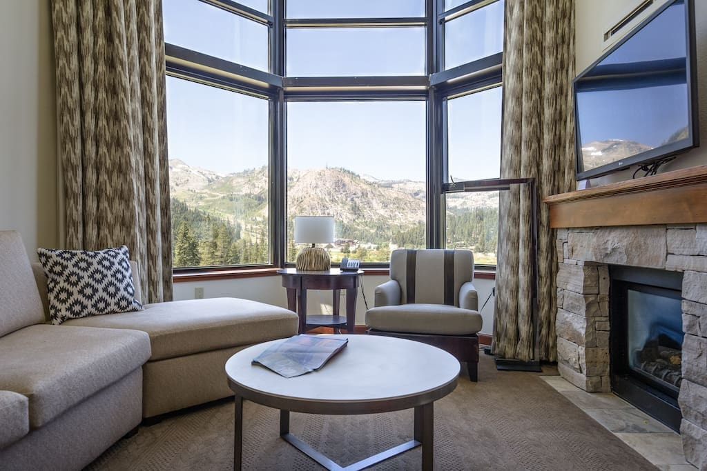 Living room featuring a gas fireplace with breathtaking views. The couch turns into additional sleeping space for two.