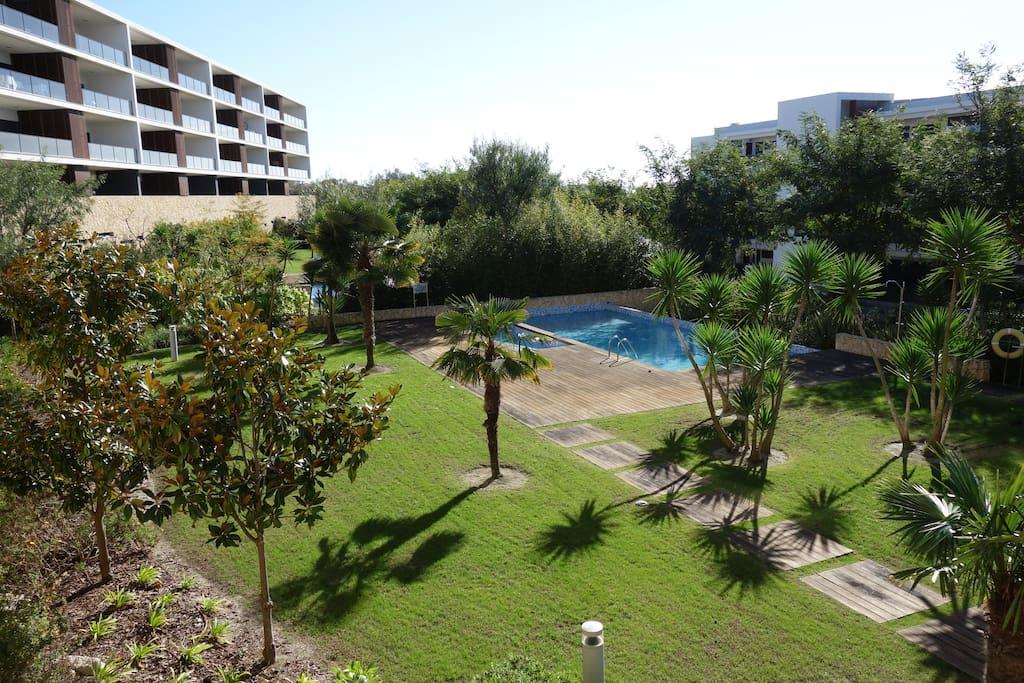 Outlook from terrace to gardens and pool.