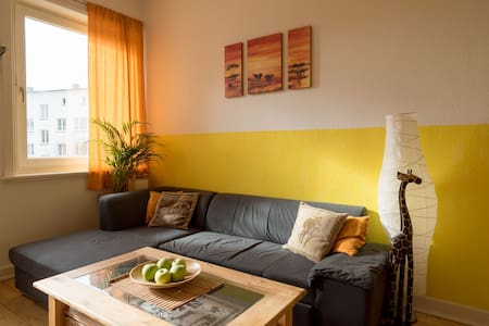 sunny livingroom with comfy couch - Hamburg