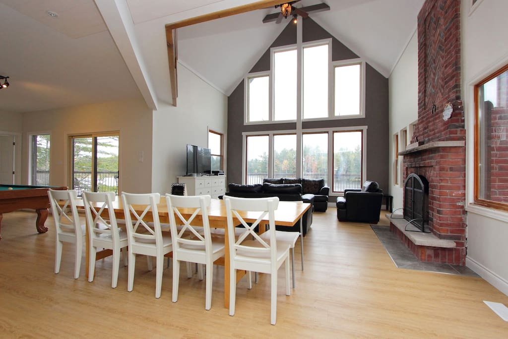 Dining room overlooking living room and waterfront