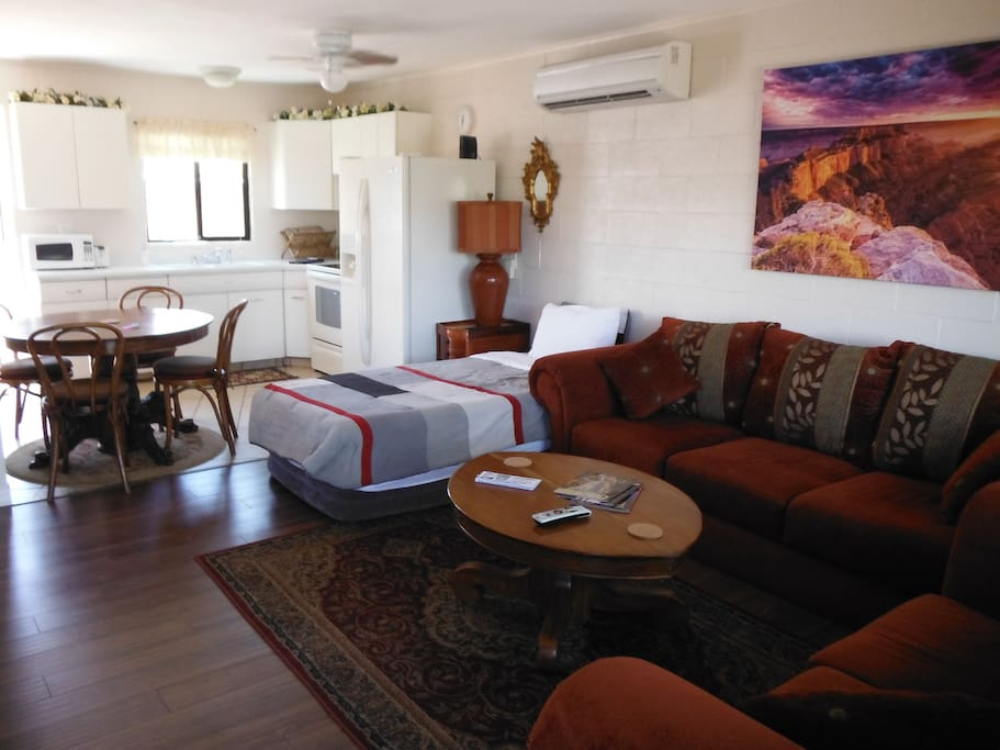 Spacious living area with a large and comfy couch, suitable for a 3rd guest, inflatable twin mattress allows for 4th