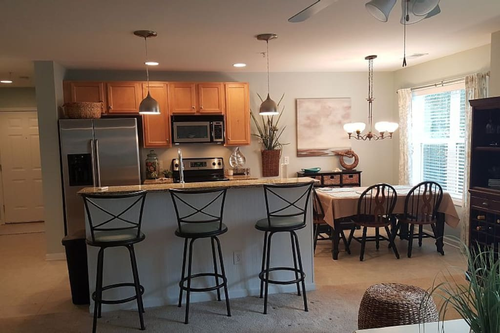 Open Kitchen area with granite and stainless steel appliances