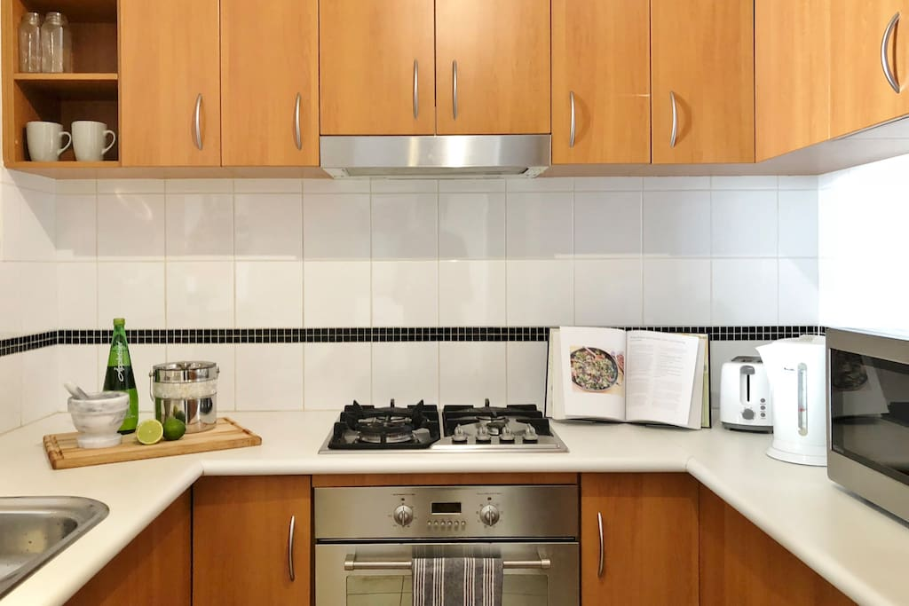 Modern kitchen with appliances and utensils for your cooking needs
