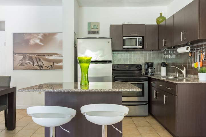 Spacious kitchen with big Island, stove, oven, microwave, coffee maker and more.