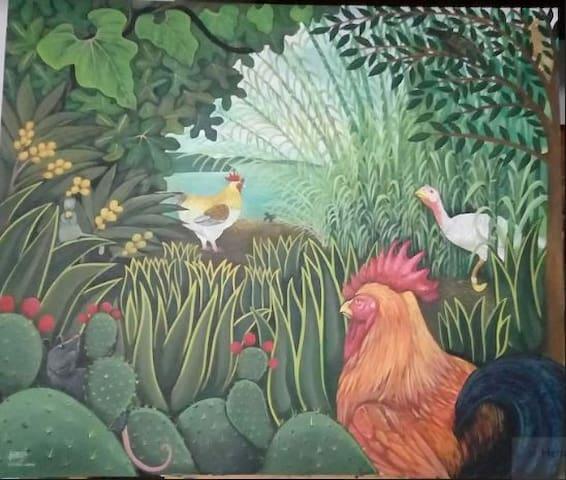 Uno de los cuadros Naif que refleja el tema de la habitación: campestre, rodeada de verde, relajada, informal y artística.
