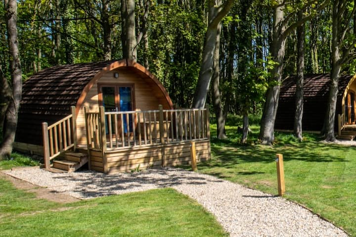 Compact, furnished glamping pod