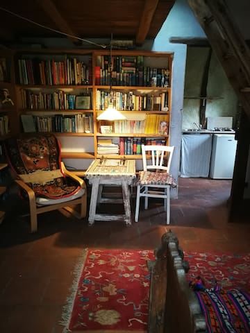 35 sq meter room with double bed on  oak mezzanine and  antique farmers bed below