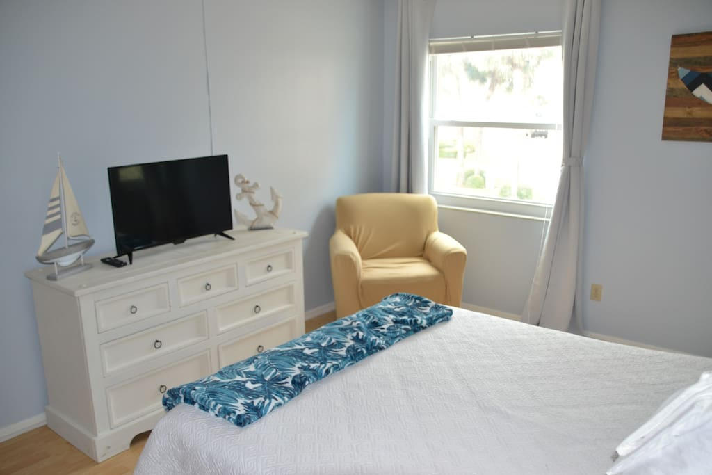 Comfortable Master Bedroom with queen bed and flat screen TV.