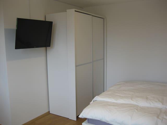 TV + wardrobe