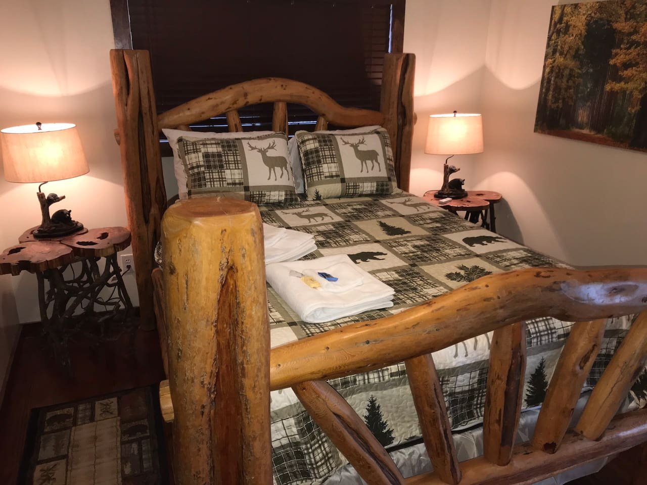 Country decor throughout unit 2 including comfy solid wood queen bed with sliding glass door overlooking backporch.