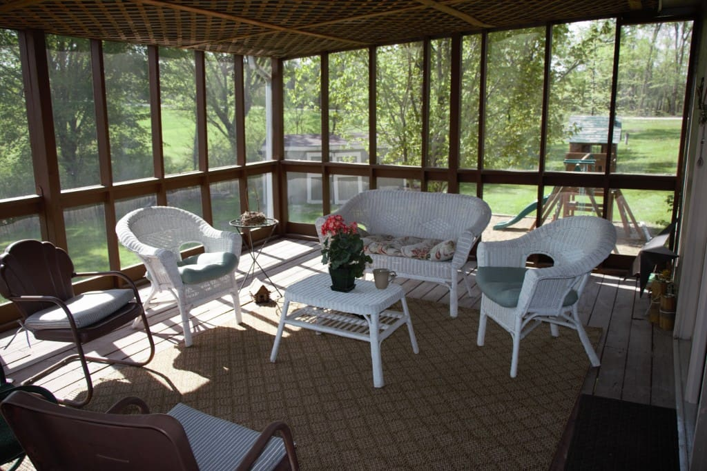 Screened in back porch.  Great for morning coffee or relaxing evening.