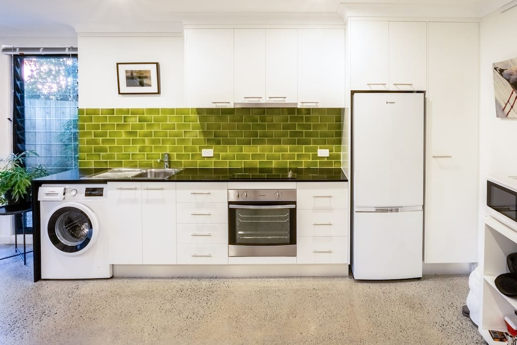 Fully Equipped Kitchen with Washing Machine.