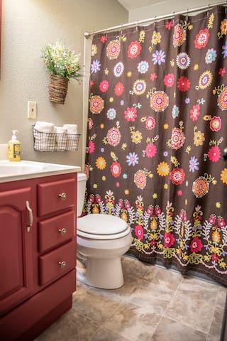 Bathroom on main floor with shower/tub combo.