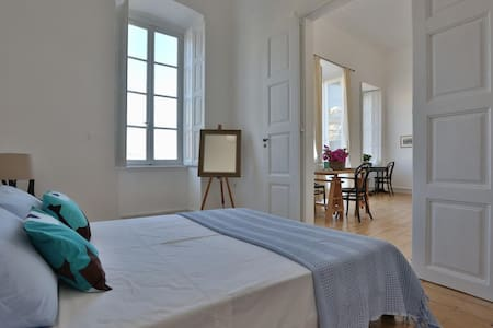 Sunny suite in a neoclassical 1870 town house