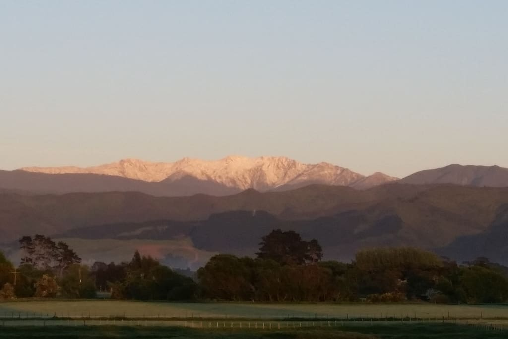 Winter snow on the Tararua mountains-view from cottage window
