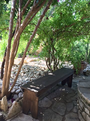 Sitting by the well under a natural shade