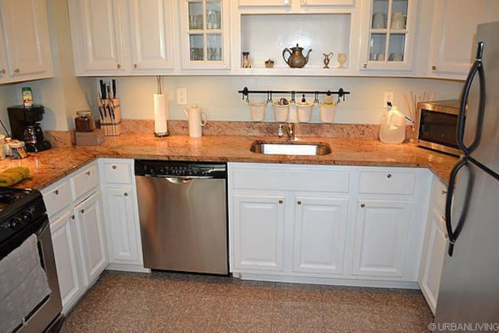 Kitchen with dishwasher, microwave, stove/oven, coffee maker, fridge