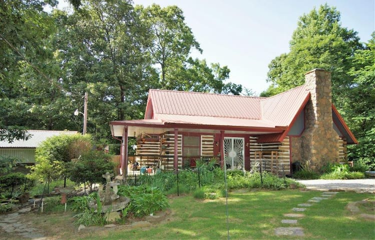 Quite , secluded four bedroom cabin on 6.5 acres.