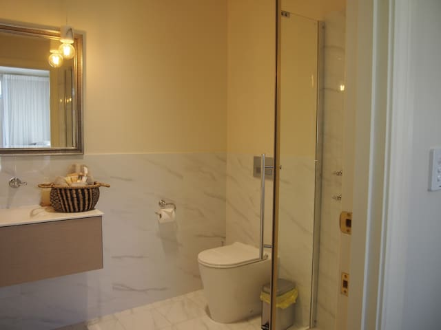 Modern Ensuite Bathroom with complimentary shampoo and soap