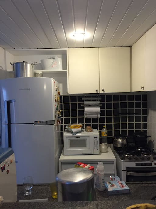 Kitchen with stove, oven, microwave, fridge and all sorts of utensils for you to cook a fine meal.