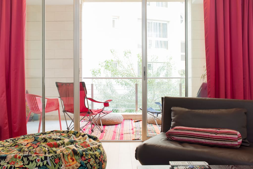 Shared living room with a cute balcony seating to enjoy your morning coffee