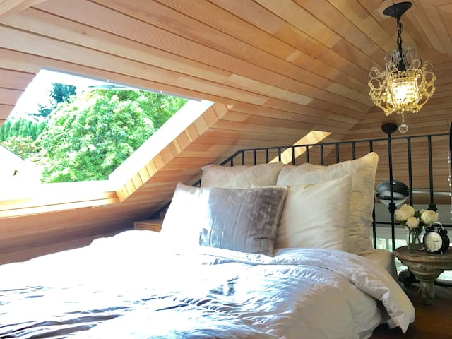 Queen size memory foam bed, and giant operable skylight.  See the stars at night!
